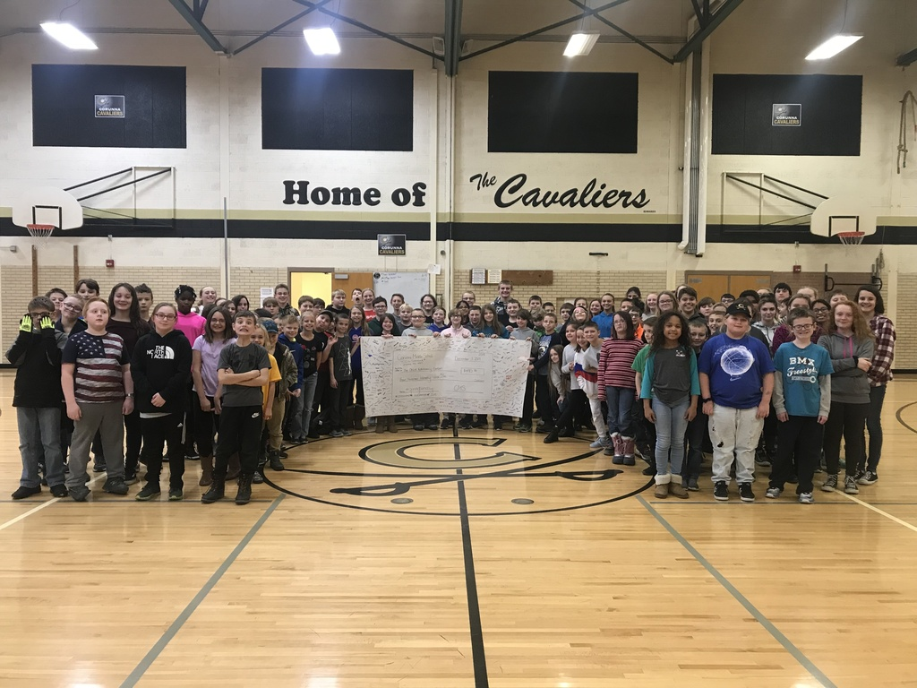 CMS Students and Staff with check for Advocacy Center